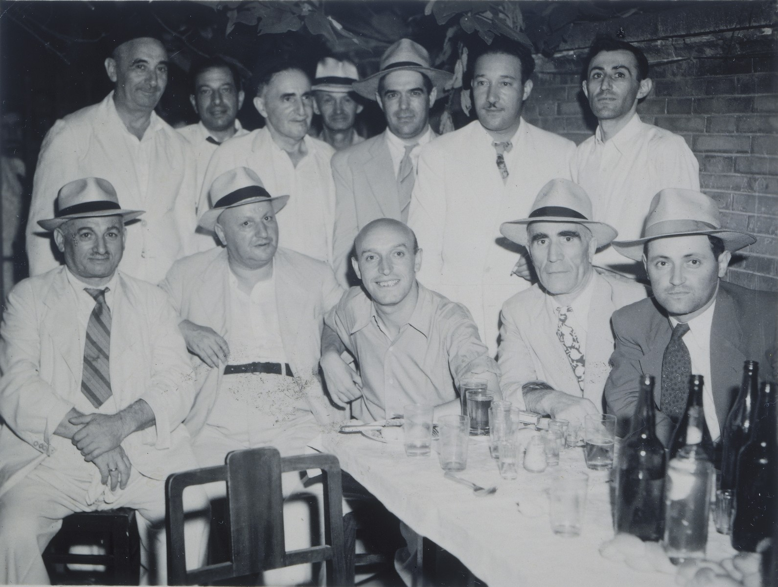 Group portrait of members of the Mir Yeshiva in Shanghai.  Hirsch Millner is seated at the bottom right.  Eli Rolavsky is standing on the far right.