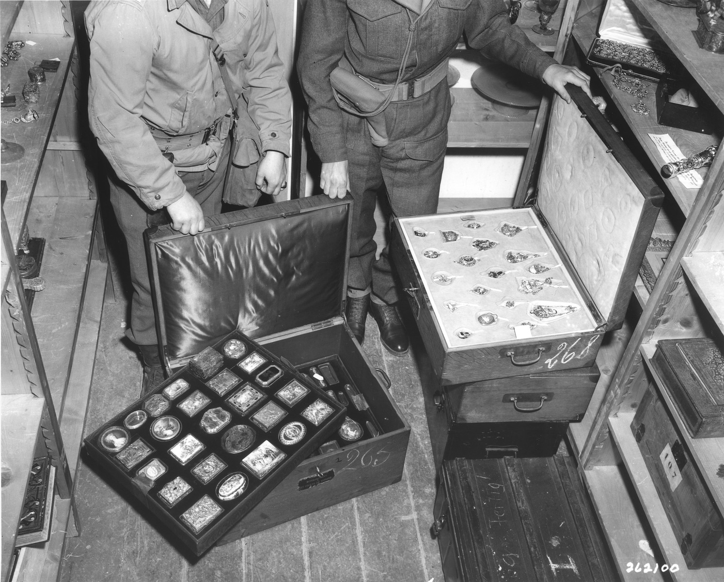 American soldiers open cases of jewels and snuff boxes looted from the home of Maurice Rothschild in Paris and brought to Germany.