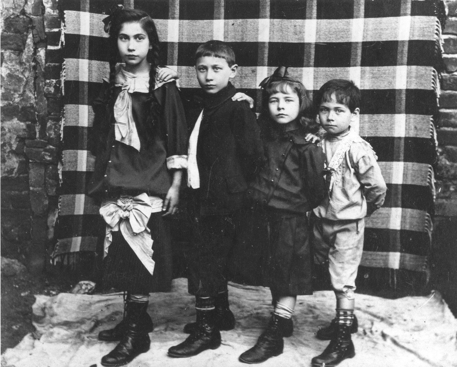 The four Goldfajs siblings pose in front of a blanket at their home in Warsaw.    Pictured second from the right is Jenta Goldfajs, the donor's mother.