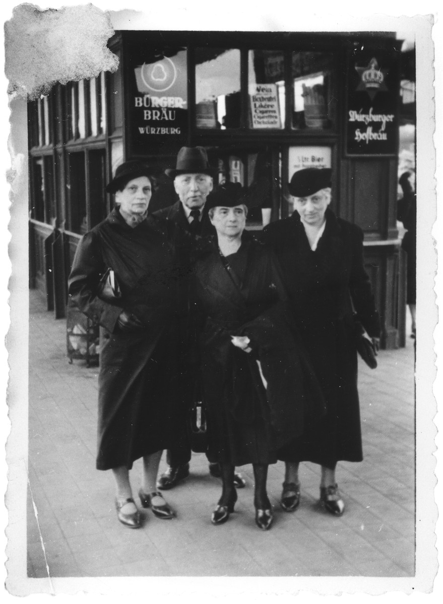 The three Wassermann sisters pose on a commercial street in Würzburg.  Pictured from left to right are the three sisters of Eugen Wassermann: Emma (Wassermann) Sommerich, Betty (Wassermann) Offenstadt and Gerta (Wasserman) Koehler.  All were able to emigrate from Germany.