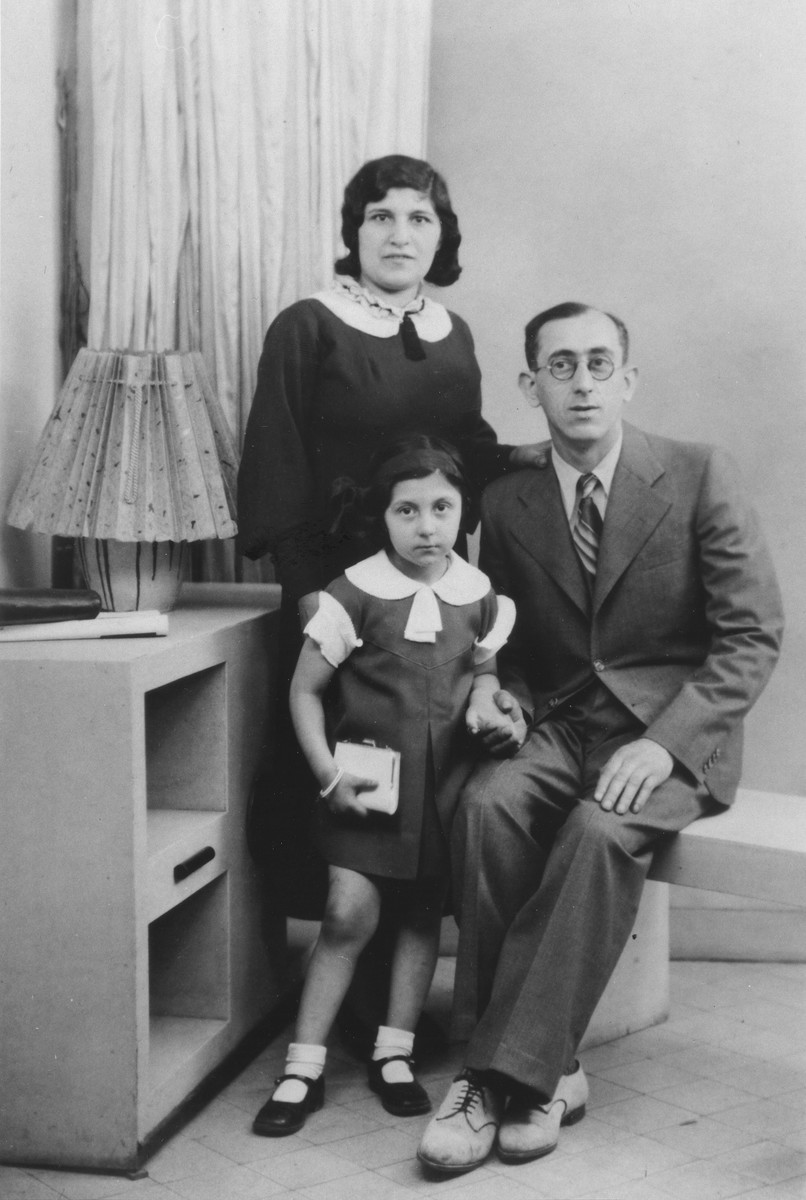 Studio portrait of the Kokotek family in Paris.  Pictured are Wolf and Bronia Kokotek with their daughter Rachel.