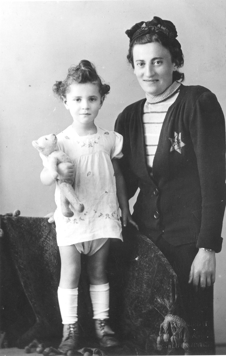 Helena Husserlova, wearing a Jewish badge, poses with her daughter Zdenka shortly before their deportation to Theresienstadt.
