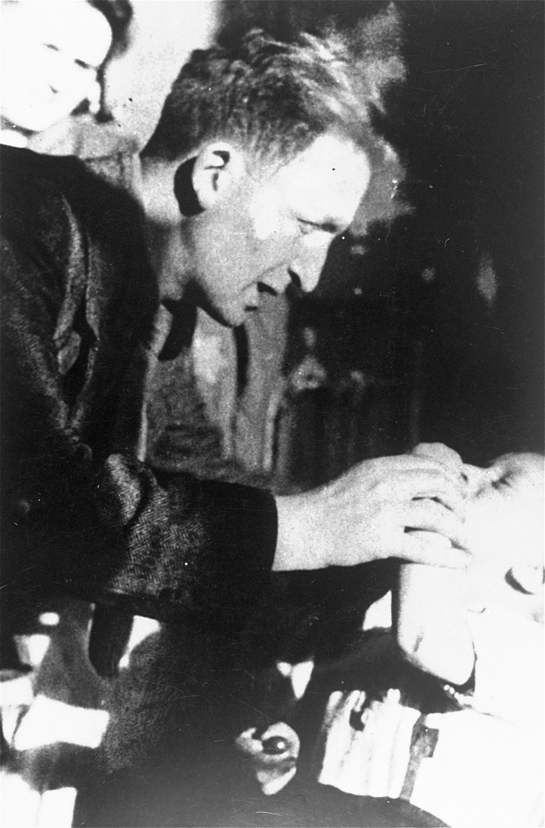Mendel Grosman plays with his nephew Yankele Freitag in his apartment in the Lodz ghetto.