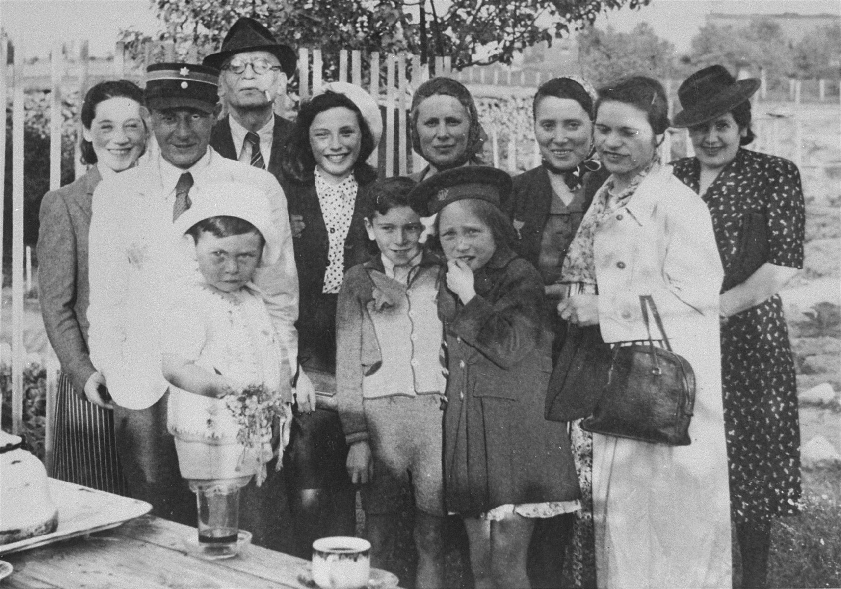 Mordechai Chaim Rumkowski, chairman of the Lodz ghetto Jewish Council and Zygmunt Reingold, head of food supply, pose with family members in the ghetto.