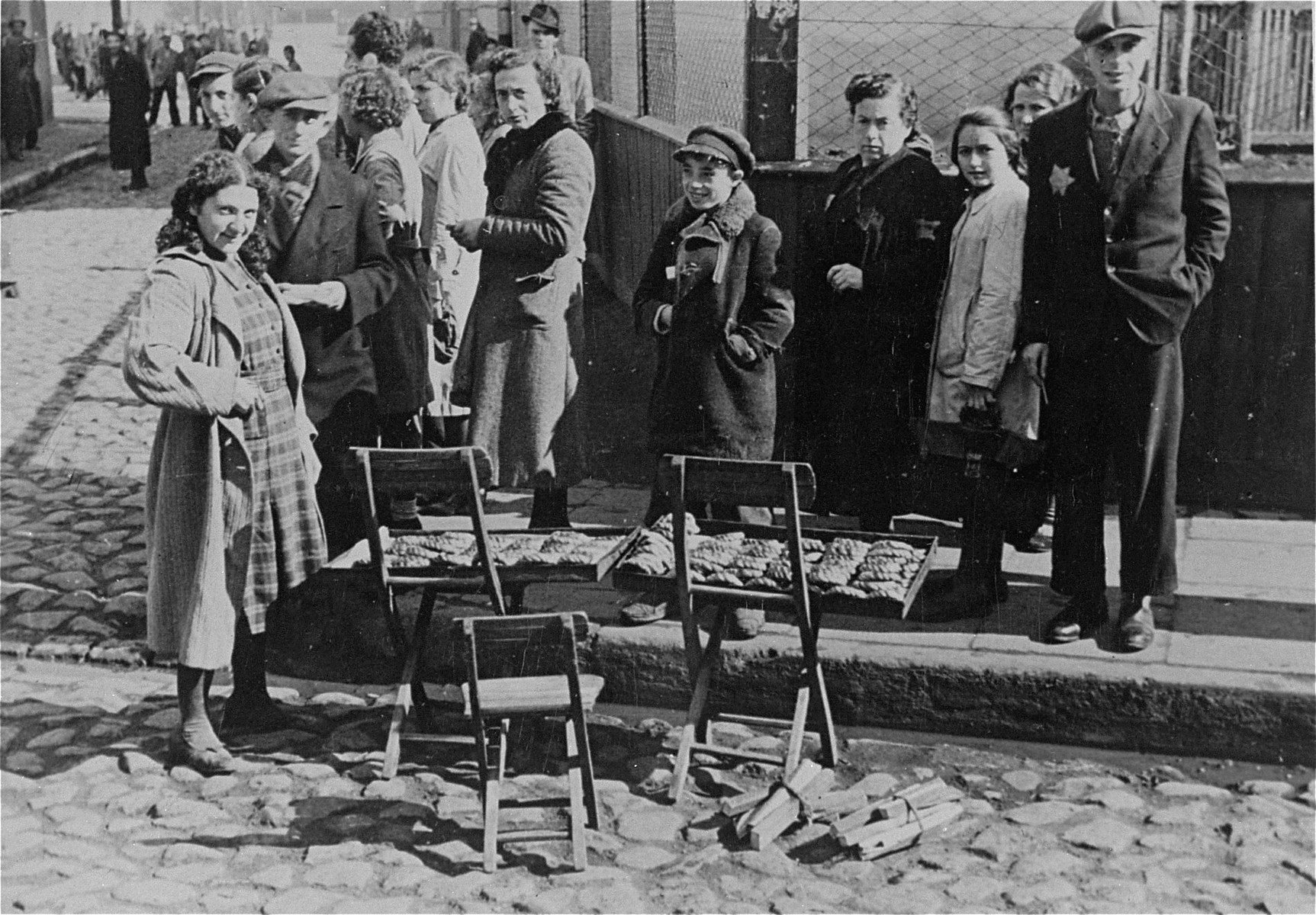 A young woman selling food on the streets of the Lodz Ghetto.