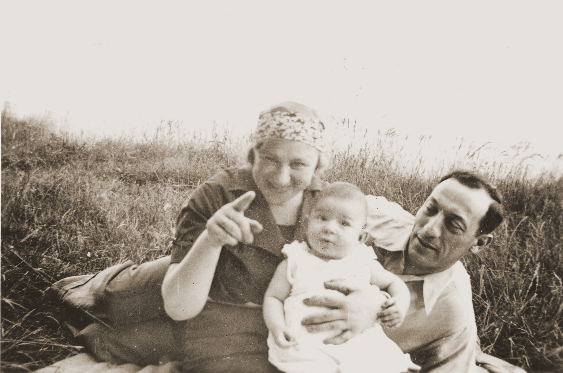 Bernhard and Sonja Schadur Goldstein with their daughter Evgenia sitting in a field.    Sonja was the sister of Michel Schadur, whom he set up in the fruit business in Berlin in the early 1930s.  Sonja married a German-Jew, Bernhard Goldstein and had one daughter while living in Berlin.  After Kristallnacht Bernhard was imprisoned briefly in Sachsenhausen.  Upon his release the family fled to Antwerp.  In March 1940 they secured American visas and sailed to the U.S.