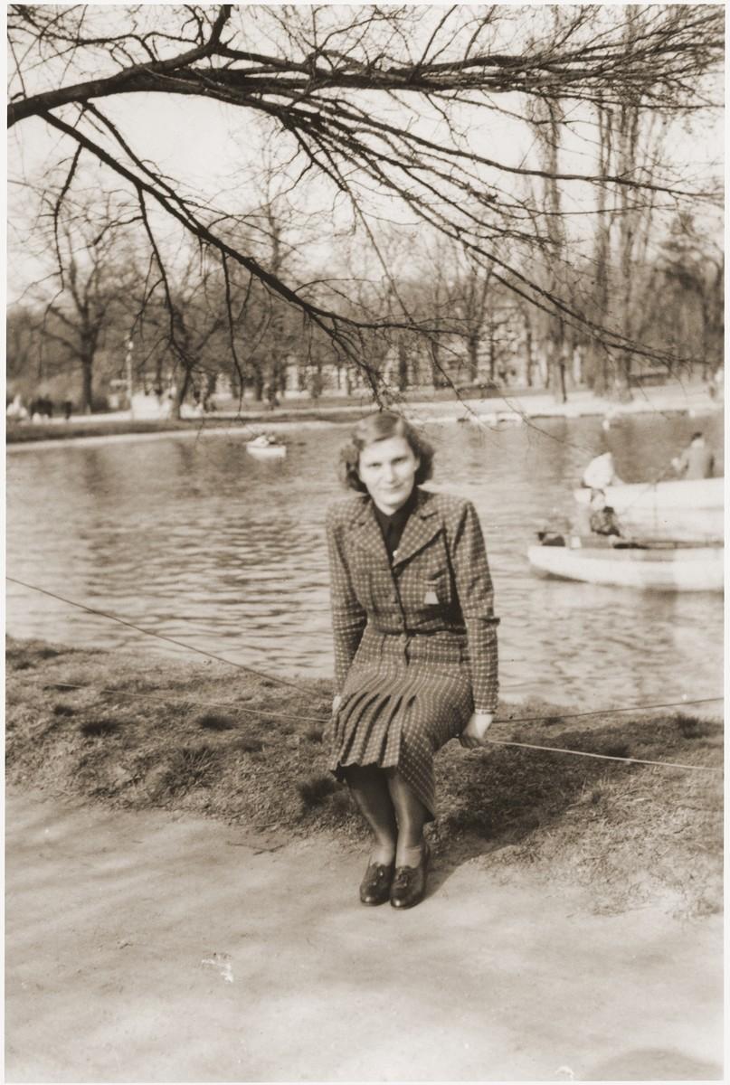 Kathe Spiegler, the half-sister of Eugen Spitzer, poses near a pond in Vienna.