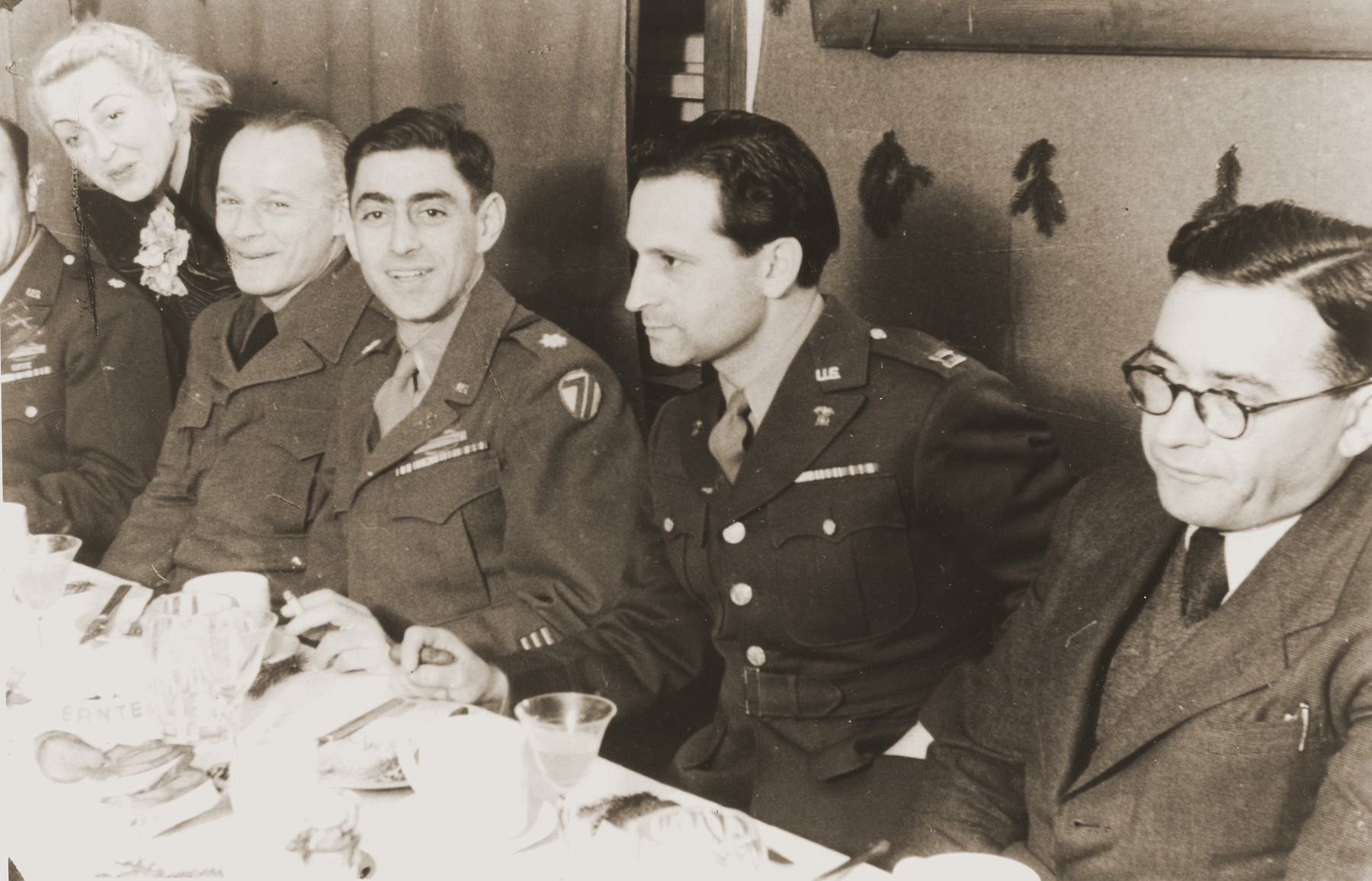 Farewell dinner for Major Irving Heymont and Captain David Trott marking their departure as administrators of the Landsberg DP camp.  Among those pictured are (from left to right) Ala Gringauz (nee Bergholz), Dr. Abraham Glassgold, UNRRA director, Major Irving Heymont, Captain David Trott and Dr. Samuel Gringauz.
