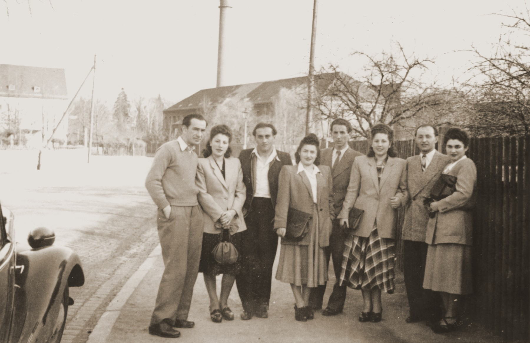 Group portrait of Jewish DPs on a street in the Fuerth displaced persons camp.    Pictured from left to right are Drujak, Regina Rosenberg, Kazik Plawner, Sala Rafalowicz, Cudek Rosenberg, Esther Rosenberg Blacharowicz, Tadek Blacharowicz and Eugenia Lanceter.