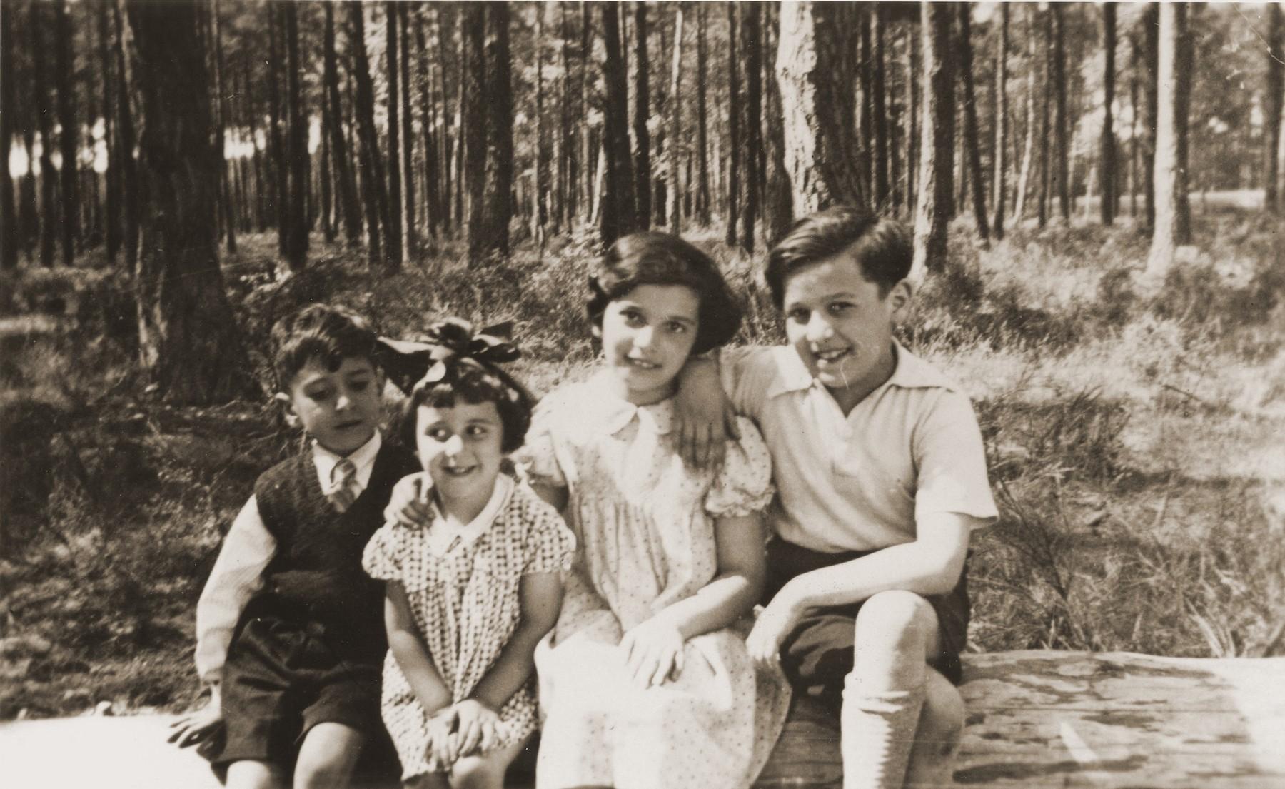 Joseph and Benita Schadur (left) with two older children in Grunewald.
