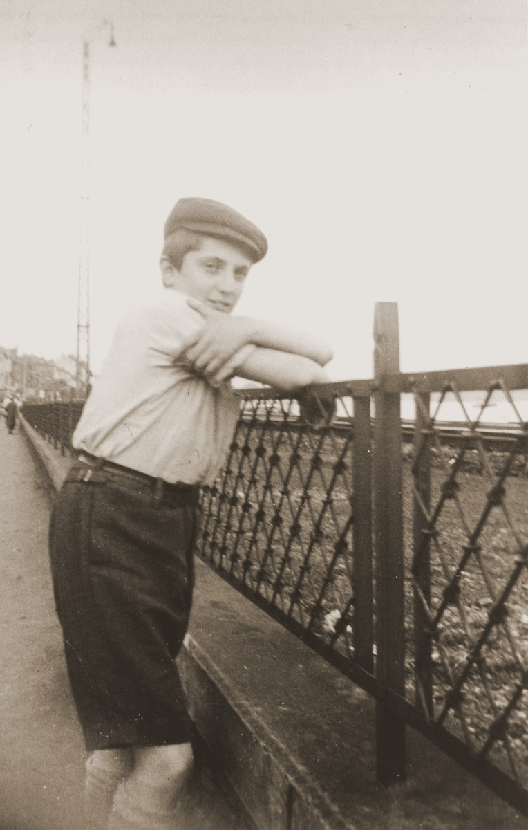 Chaim Wilshanski, a friend who was accompanying the donor on a bicycle trip, poses on a bridge over the Main River.