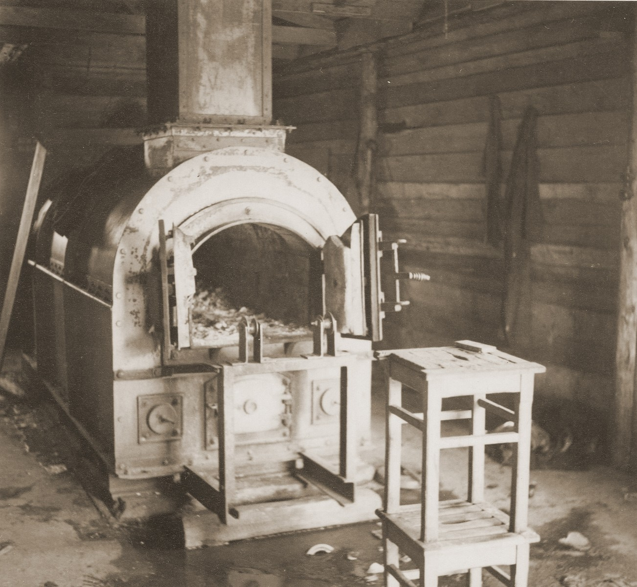 """View of the crematorium oven at Bergen-Belsen.    The original caption reads """"The furnace in the crematorium where the Germans burned the bodies of their thousands of victims."""""""