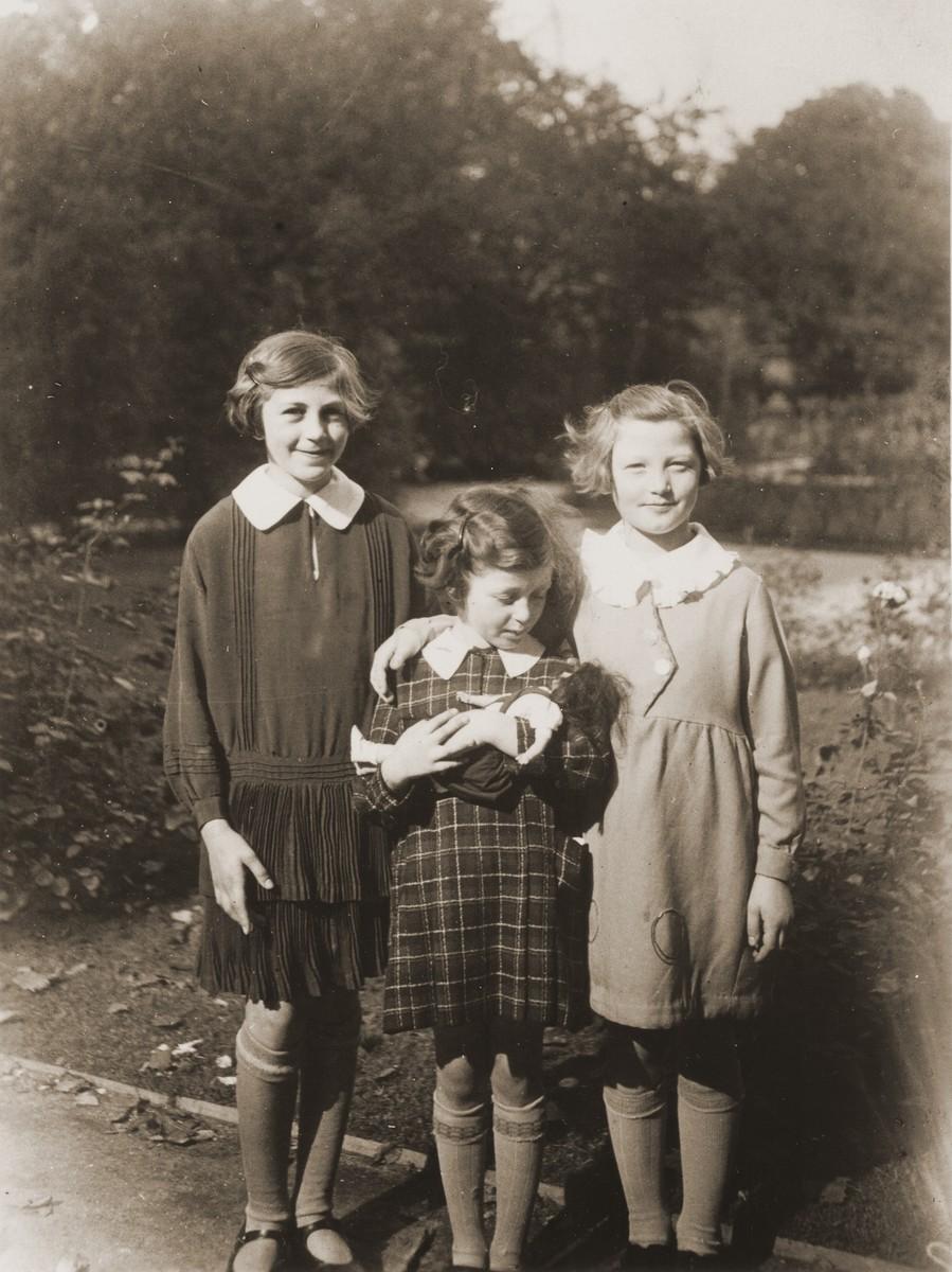 Three Jewish sisters pose in a park.  Pictured are Trudel, Miri and Emmi Farntrog.
