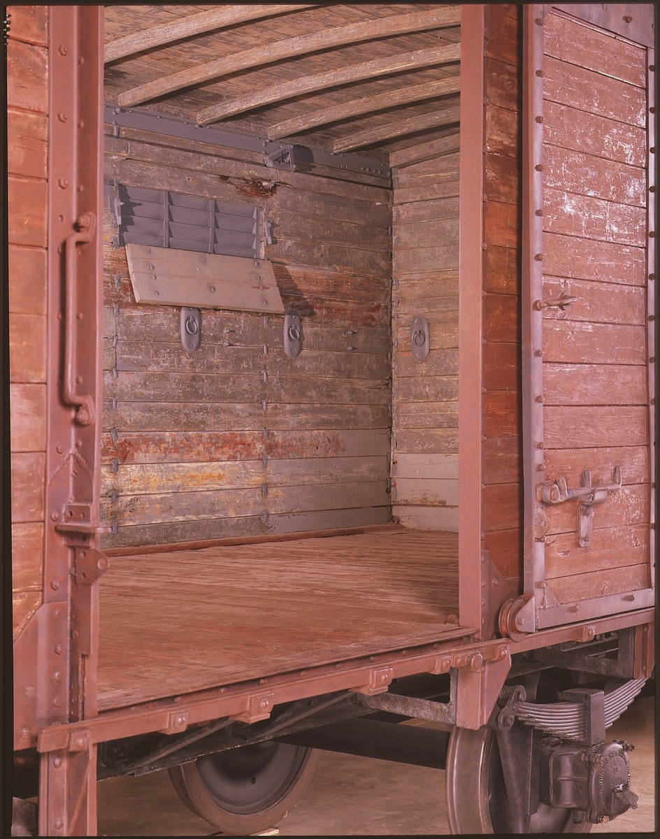 Interior view of the railcar on display in the permanent exhibition of the U.S. Holocaust Memorial Museum.  The railcar is of the Karlsruhe model, one of several types of freight cars used to deport Jews to ghettos and concentration camps.