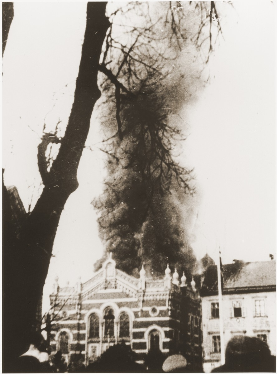 Local residents watch as flames consume the synagogue in Opava, set on fire during Kristallnacht.