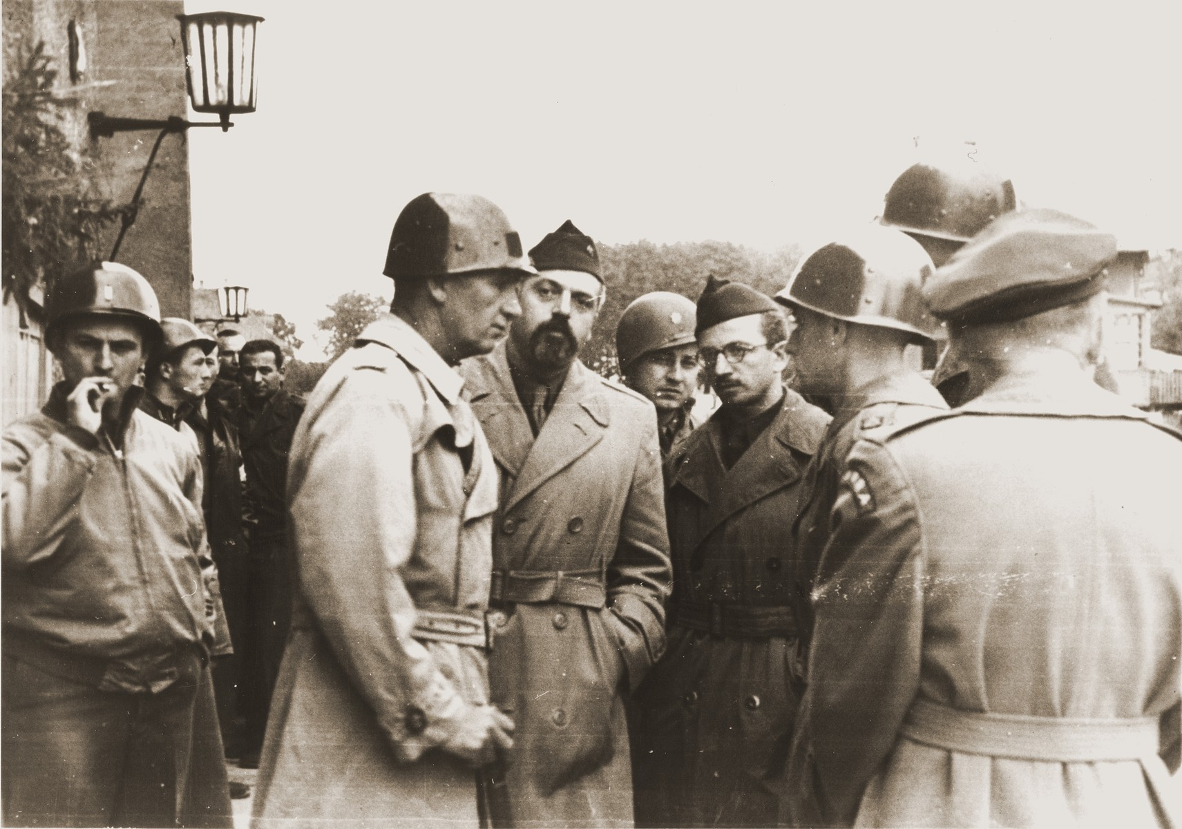 American military officers meet with officials from UNRRA and the Joint Distribution Committee in the Landsberg displaced persons camp.   Pictured from left to right are: Captain David Trott, Rabbi Abraham Rosenberg from the JDC, Hy Stuchin from the Canadian Joint Distribution Committee, and Mr. Craddock director of UNRRA.  Also pictured are Major Irving Heymont and General William McBride.