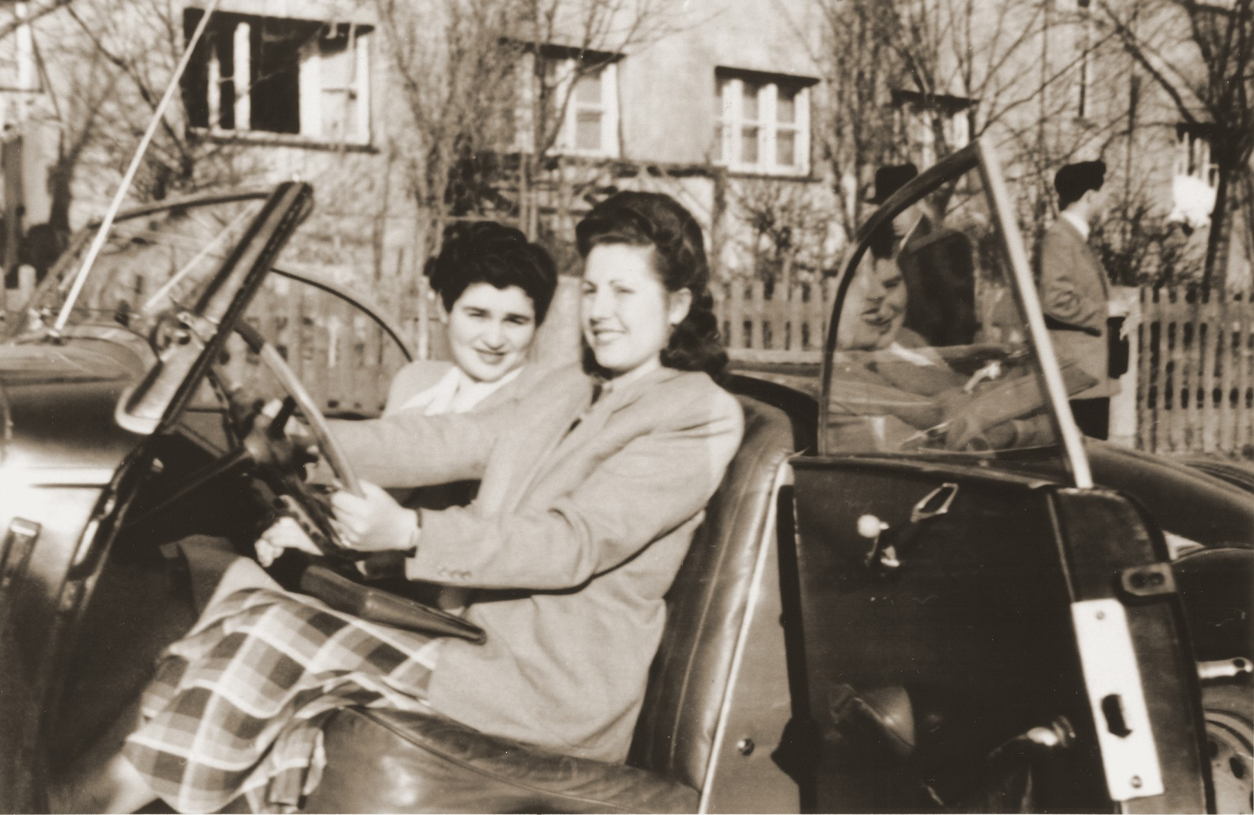 Two Jewish DP women sit in an automobile at the Fuerth displaced persons camp.  Pictured are Esther (Rosenberg) Blacharowicz (right) and Eugenia (Hochberg) Lanceter (left).