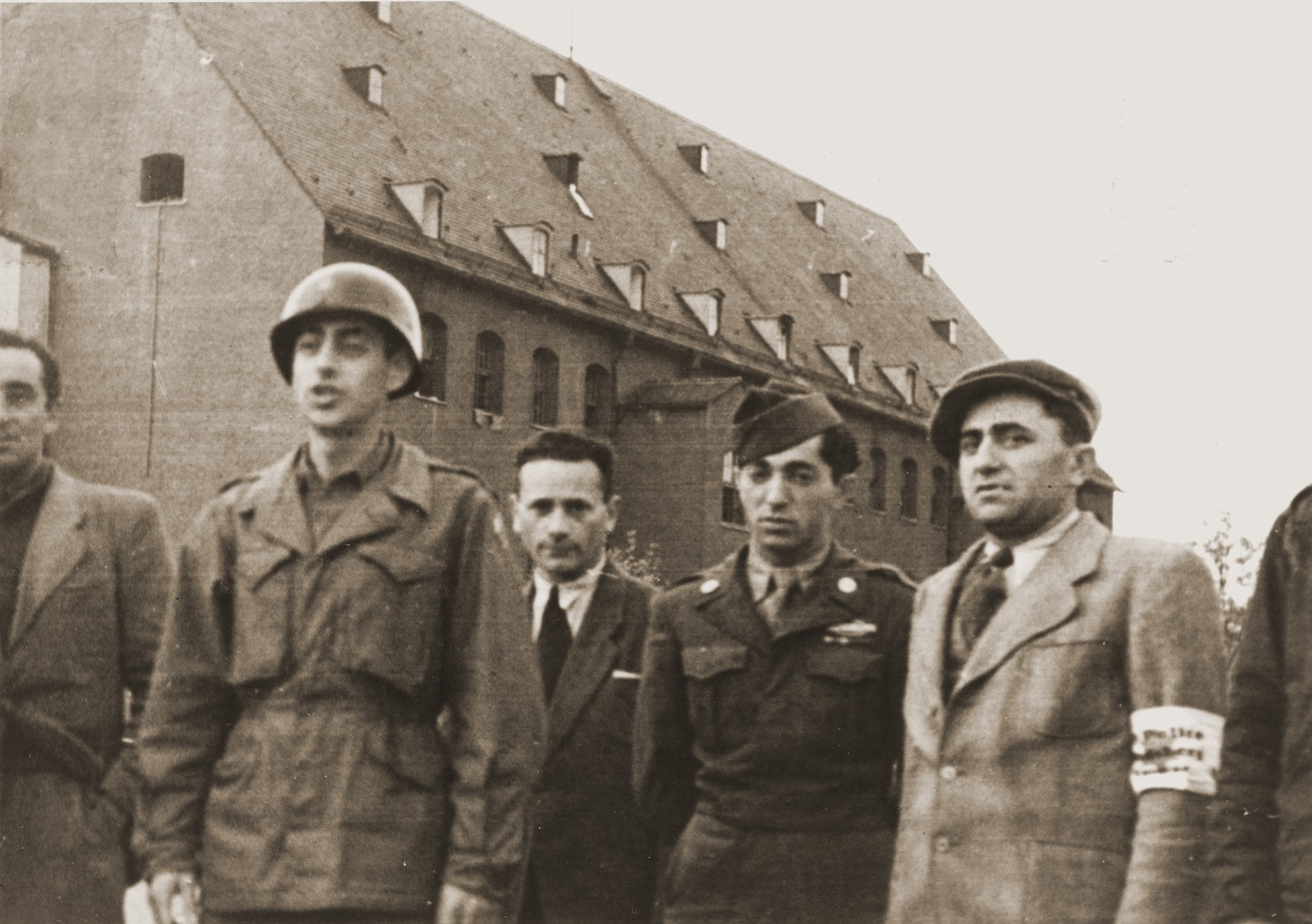 Major Irving Heymont and Pfc. Markovitz speak to the Jewish police in the Landsberg displaced persons camp.  Pfc. Markowitz served as the US army's supervisor of the Jewish camp police.  The police curbed the more flagrant violations of black marketeering.