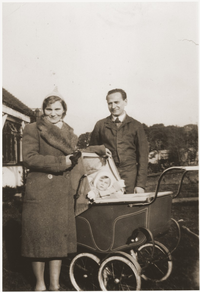 An Austrian Jewish family in Vienna in 1939.  Willy Spiegler poses with his wife, Kathe, and young child, who is sitting in a baby carriage.  Kathe is the half-sister of Eugen Spitzer.  Soon after this photo was taken she escaped to England, where she worked as a nanny for the family of a British officer.