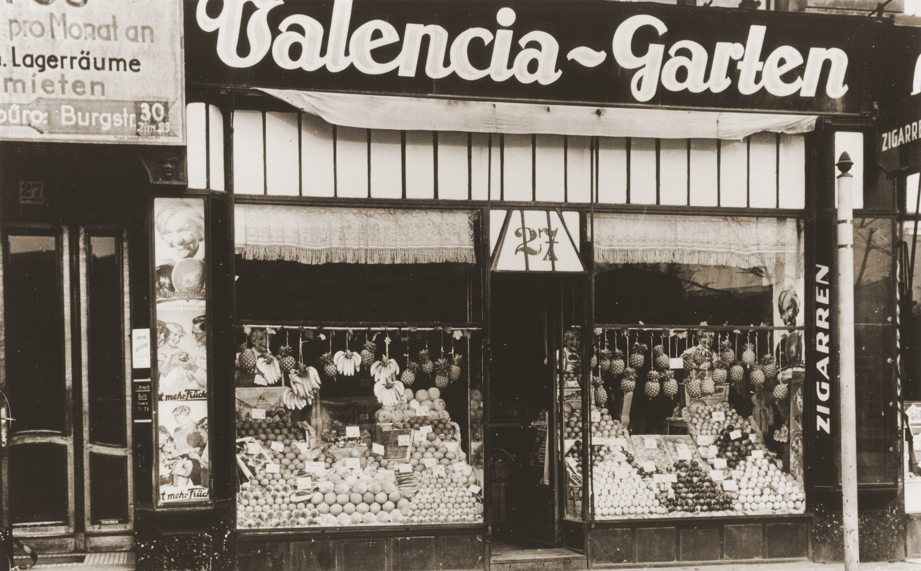 Exterior view of the Valencia-Garten, a gourmet shop on the Neue Friedrichstrasse in Berlin, owned by the donor's aunt, Gitta Schadur, a Jewish emigre from Riga.