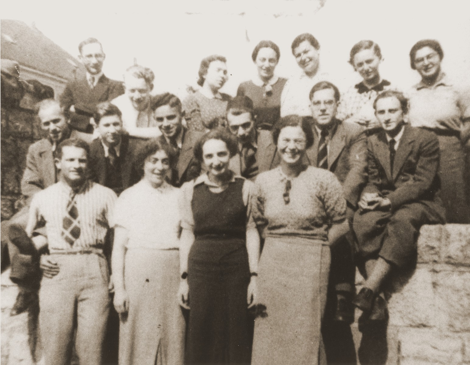 Graduating class of the Wuerzburg Jewish teachers seminary shortly before it was closed down on Kristallnacht.    Pictured in the front row from left to right are Spier, unknown, Molly Haberman, and Toni Pachtmann.  In the middle row from left to right are, unknown, Herbert Aron, Albert Schild, Rabbi Naftali Carlebach, Jacob Breuer (son of the rabbi and Gerd Zwienicki.  In the top row, second from the right, is Kathe Weiss.