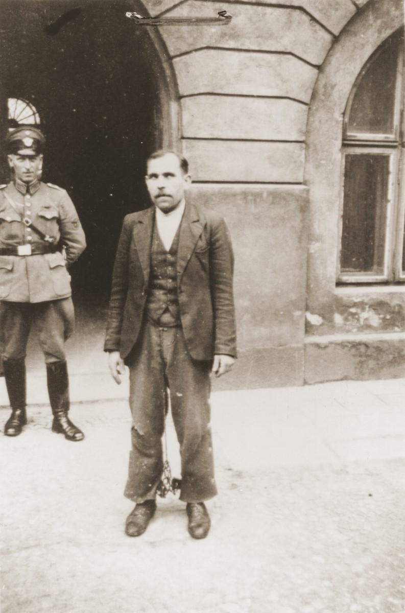 The Polish prisoner Siegmunt Swider (b. May 6, 1906) poses in the courtyard of the county courthouse in Rzeszow.  The special [SS] court sentenced him to death on April 23 and executed him on August 20, 1940.