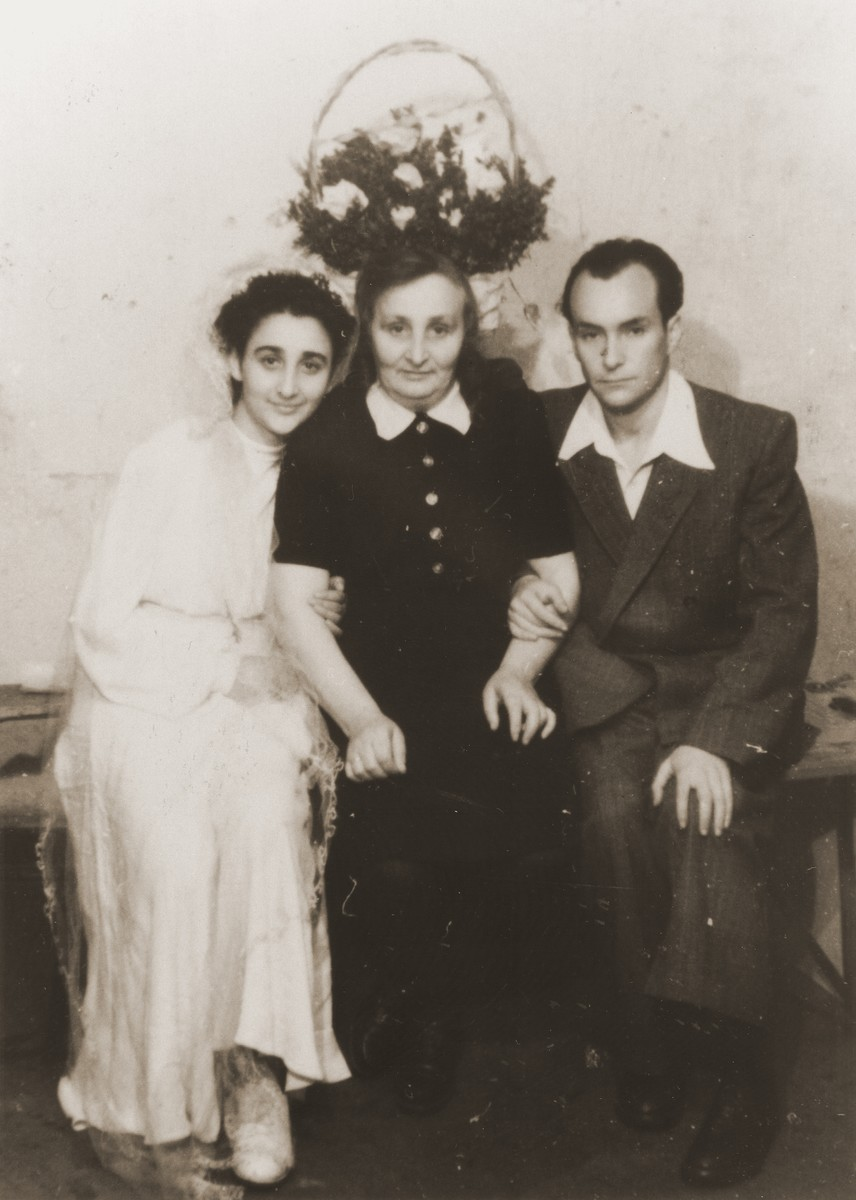 Wedding portrait of former Bielski partisan, Berl Kagan.  Pictured from left to right are Ita Rubin (the bride), her mother, Sarah Rubin, and Berl Kagan.  All three were passengers on the Exodus 1947.