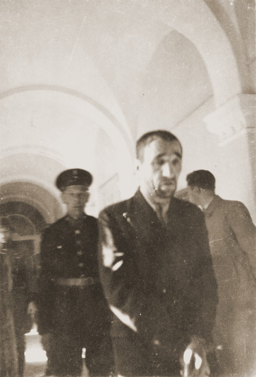 The Polish prisoner Karl Daniskewski (b. September 13, 1893) is led down the hall of the county courthouse in Rzeszow.  The special [SS] court sentenced him to death on April 23 and executed him on May 30.