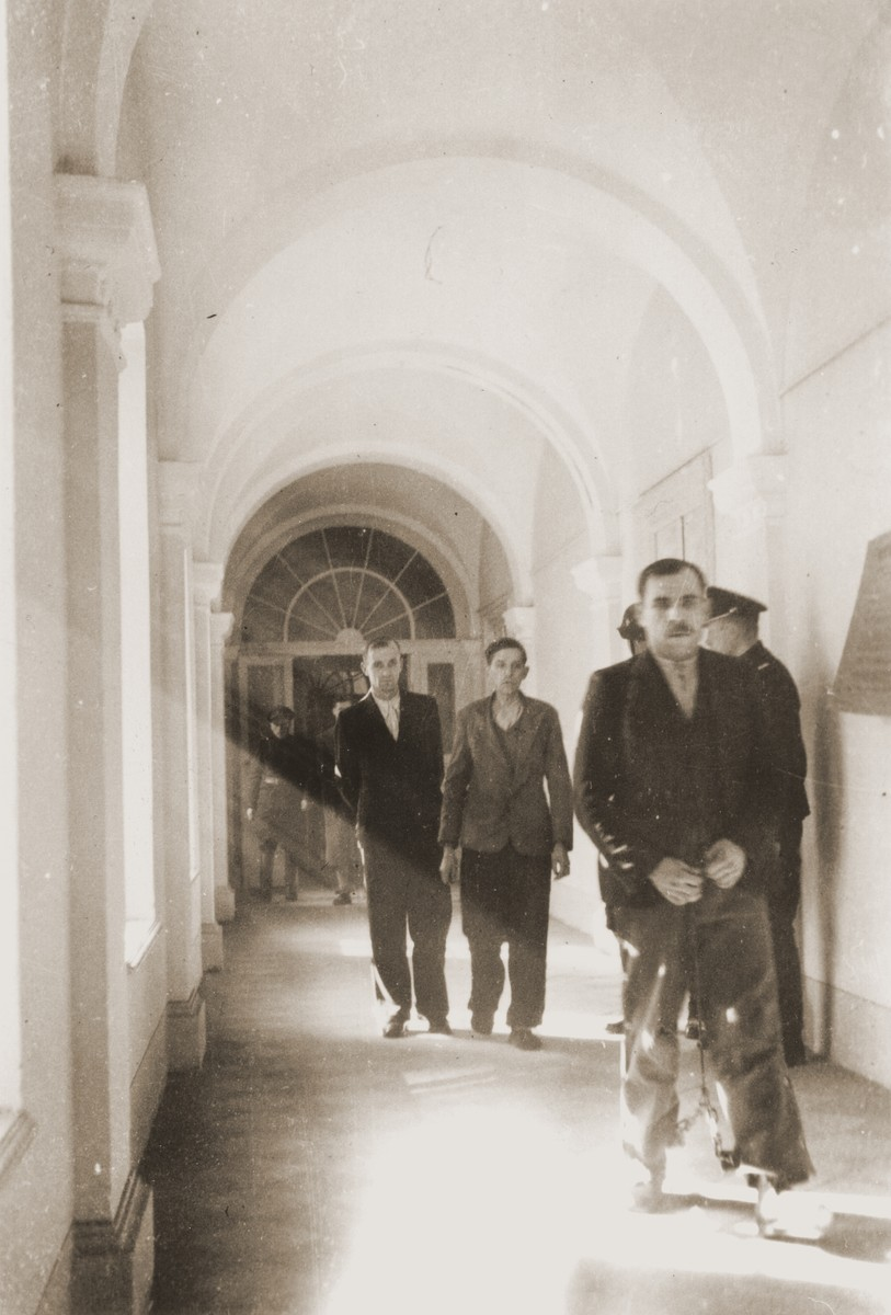 The Polish prisoner Siegmunt Swider (b. May 6, 1906) is led down the hall of the county courthouse in Rzeszow.  The special [SS] court sentenced him to death on April 23 and executed him on August 20, 1940.