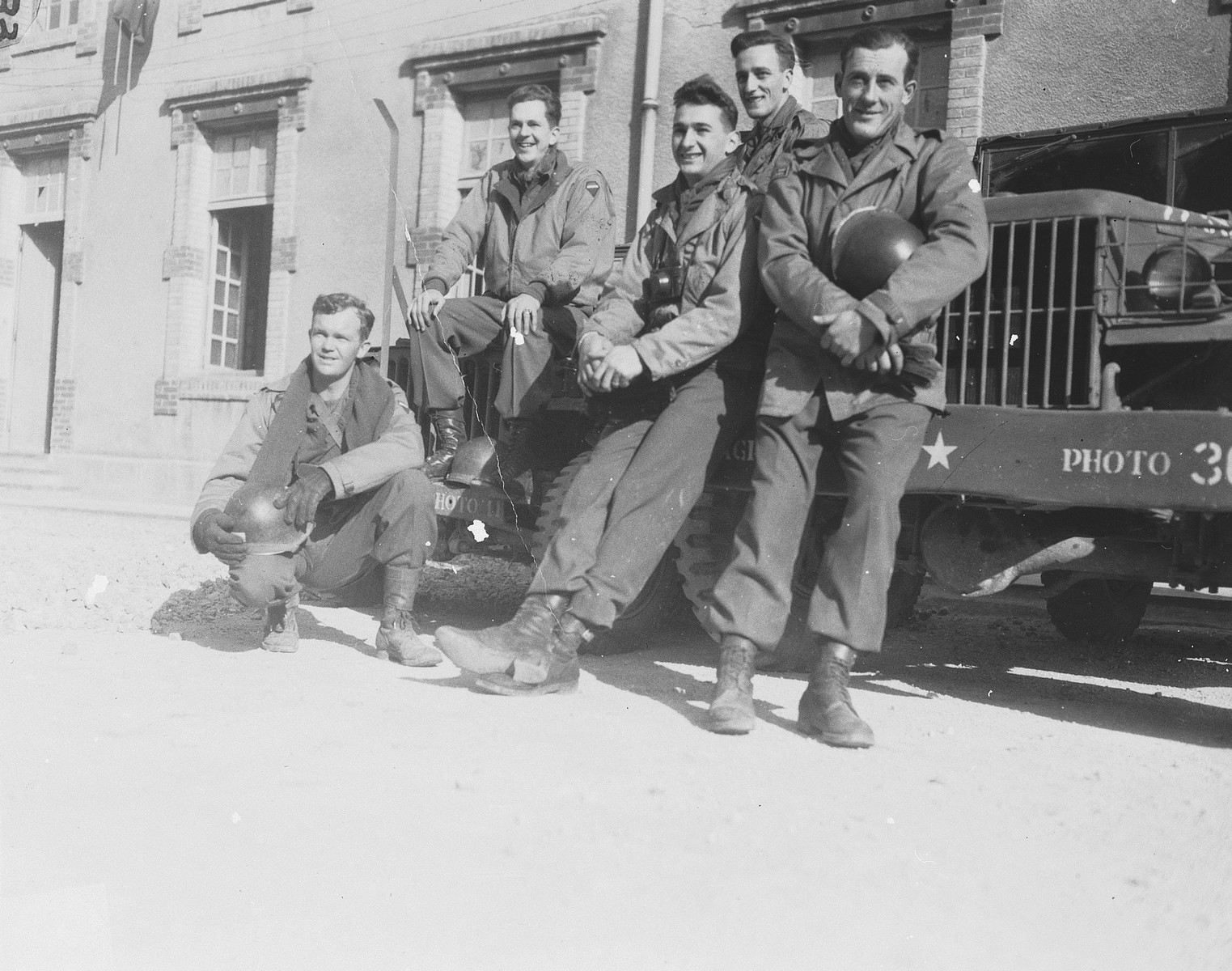 Group portrait of members of Combat Unit 123, a unit of the U.S. Army 167th Signal Photo Company.  Pictured from left to right are: Walt MacDonald, Arnold Samuelson, J Malan Heslop, John O'Brien, and Eddie Urban.