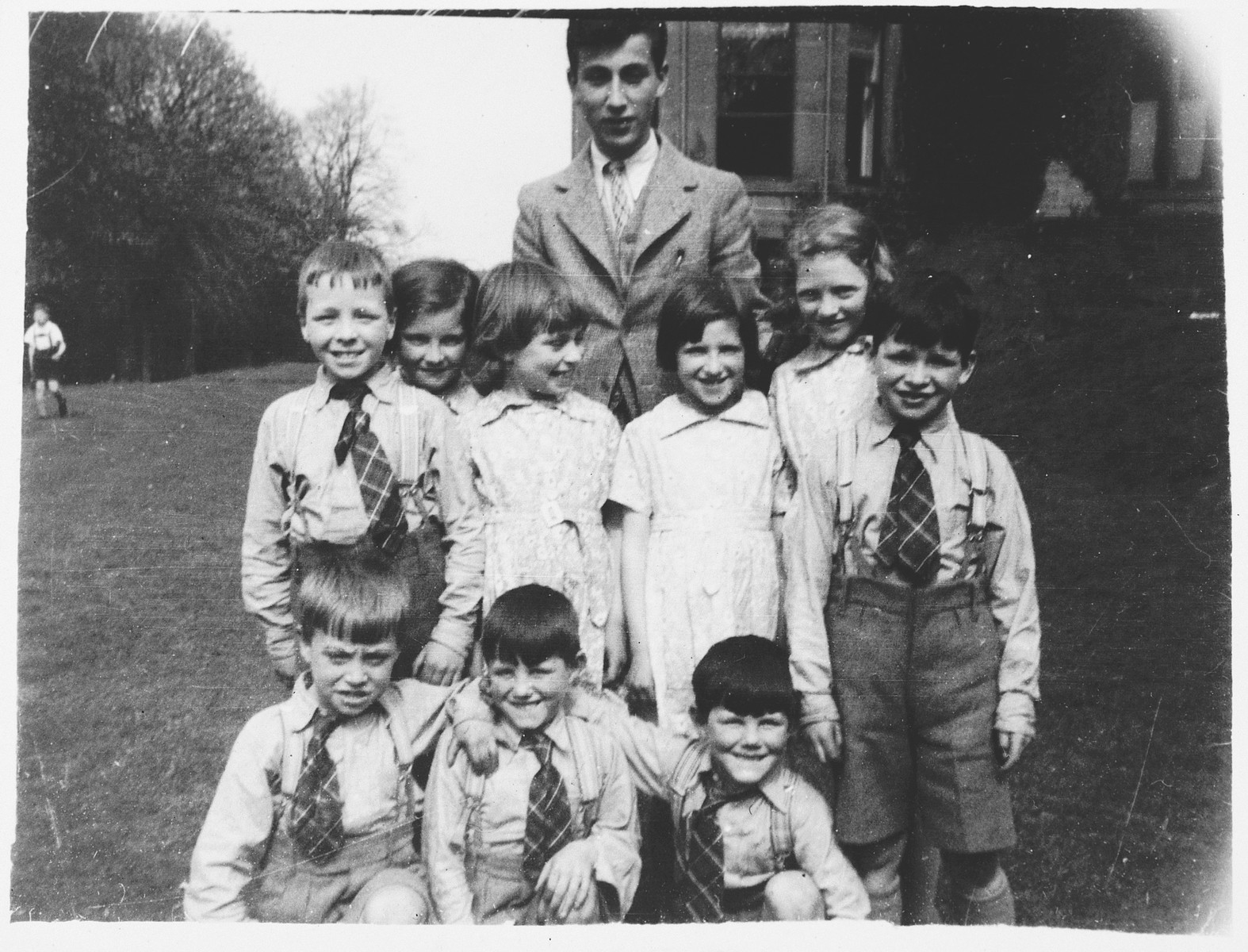 Otto Pushner (at rear) with a group of Scottish children at The Priory, a children's holiday home originally designated  for Edinburgh youngsters who had experienced abuse or stressful home circumstances.  Otto Pushner was born in Vienna.