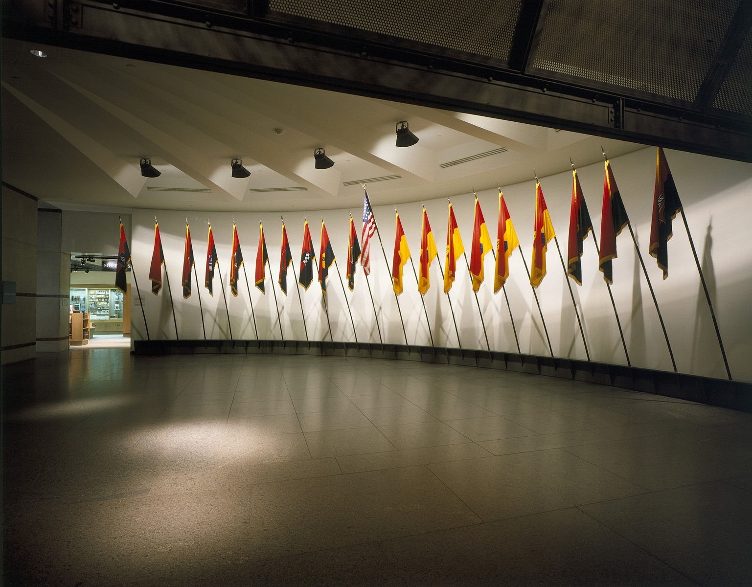View of the liberation flags located in the lobby of the 14th Street entrance to the U.S. Holocaust Memorial Museum.
