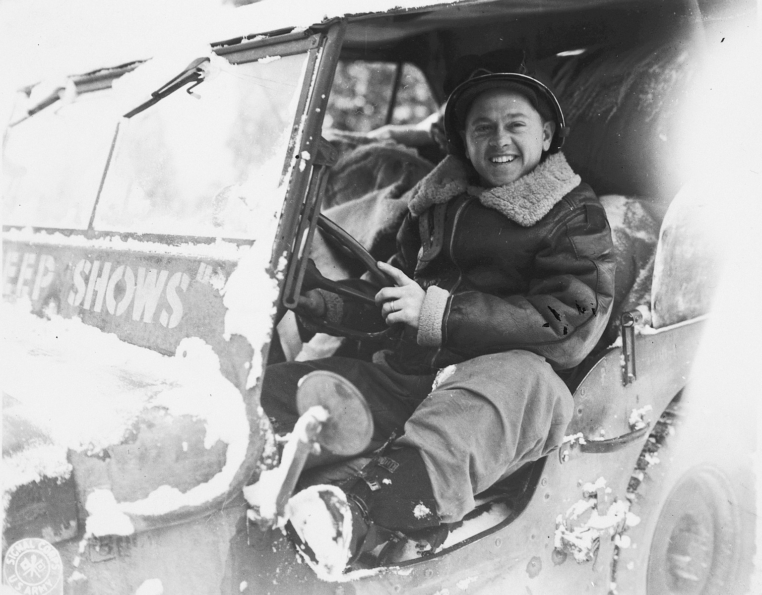 Actor Mickey Rooney poses in a military jeep during his visit to the ETO (European Theatre of Operations).