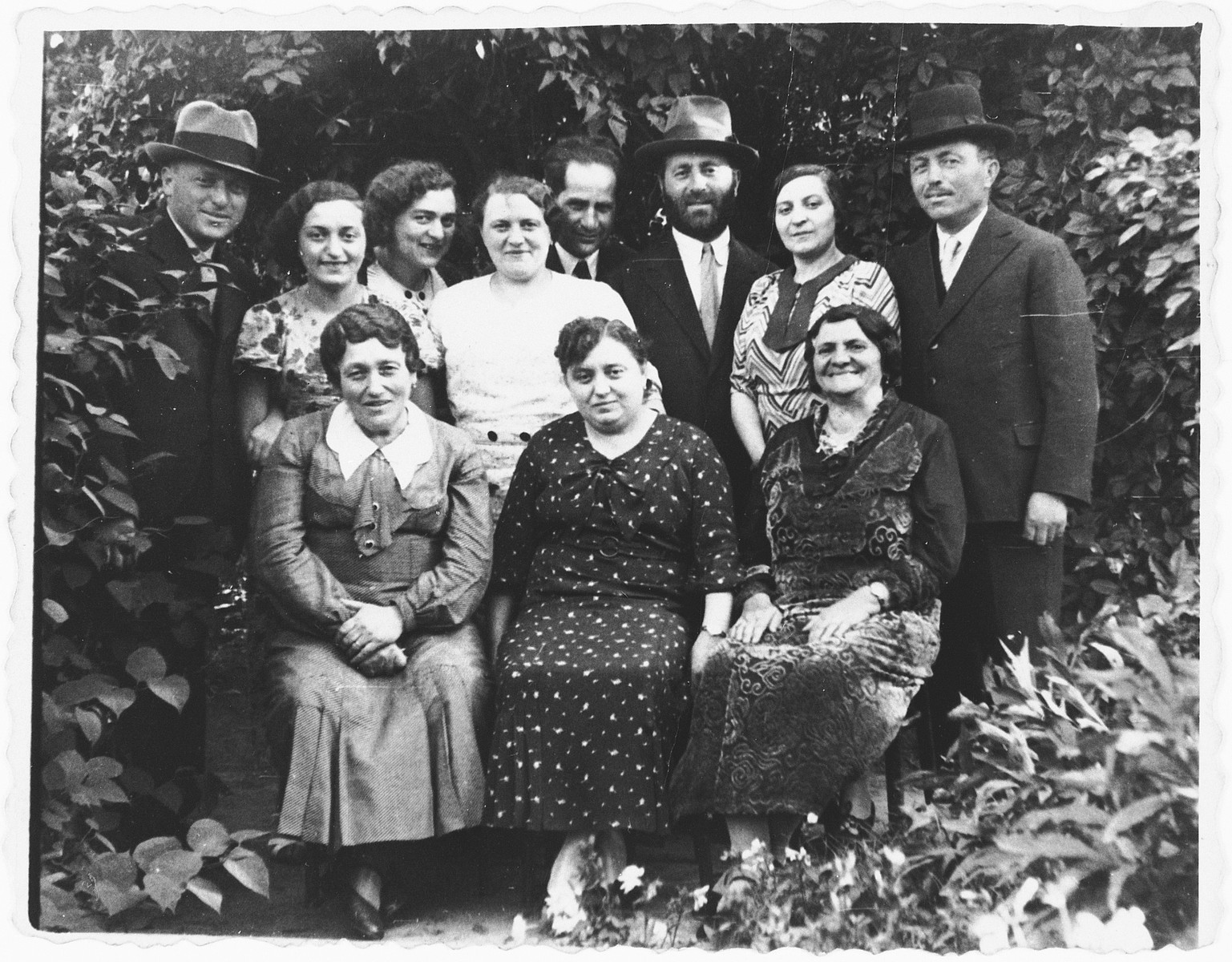 Group portrait of members of the extended Jam family in Rzeszow, Poland.  Among those pictured are Isaac and Ida (Jam) Friedberg (back row, center, Isaac is bareheaded and Ida is wearing a white blouse), and Dora, Regina, Efraim, Josef, and Memel Jam.