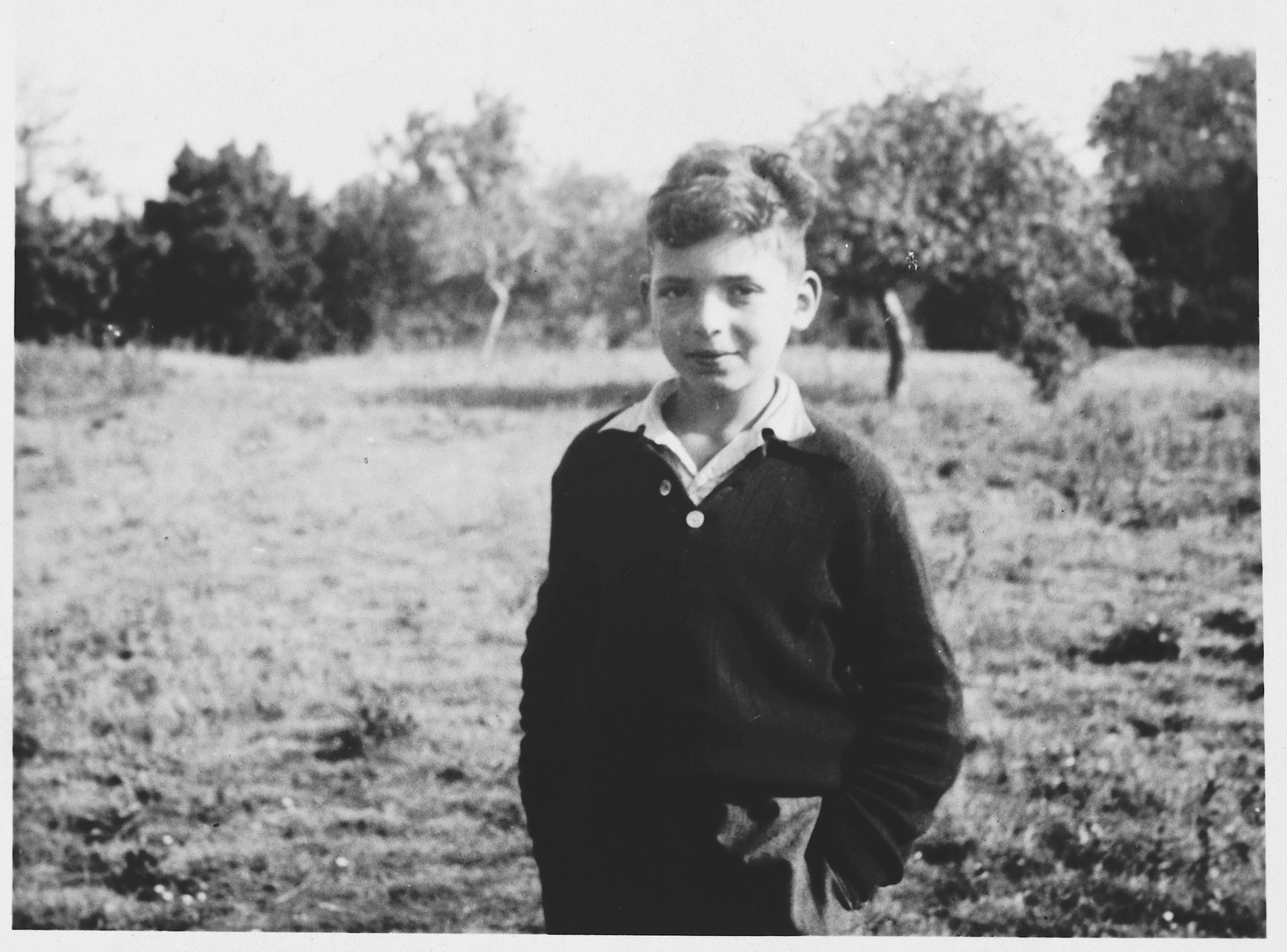 Portrait of Gunther Abrahamson in the Priory, a children's home in Selkirk Scotland.  Netta Pringle, the assistant matron in the Priory, formed warm relations with many of the twenty-one Jewish children.  She took most of the photographs, which she assembled in the album and wrote the inscriptions.  In 1996 Miss Pringle gave the album to Gunther.