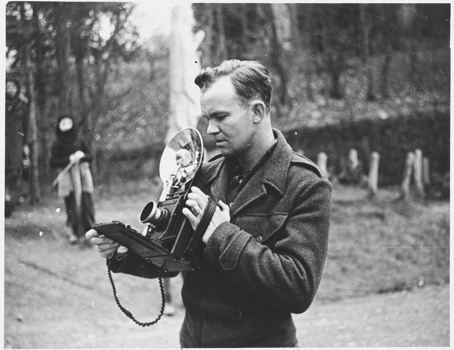 U.S. combat photographer Walt MacDonald prepares to take a picture with his speed graphic camera.