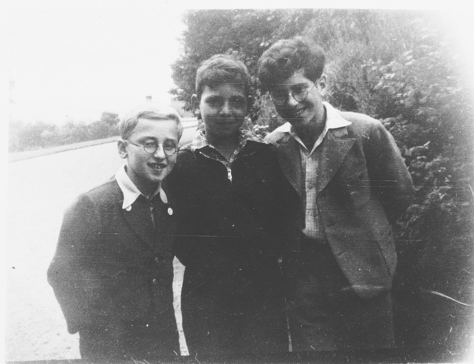 Three boys in the Priory, a children's home in Selkirk Scotland.  Pictured are Joszi Rosenzweig (Vienna),Gunther Abrahamson (Berlin) and Hans Silberstein (Danzig)  Netta Pringle, the assistant matron in the Priory, formed warm relations with many of the twenty-one Jewish children.  She took most of the photographs, which she assembled in the album and wrote the inscriptions.  In 1996 Miss Pringle gave the album to Gunther.