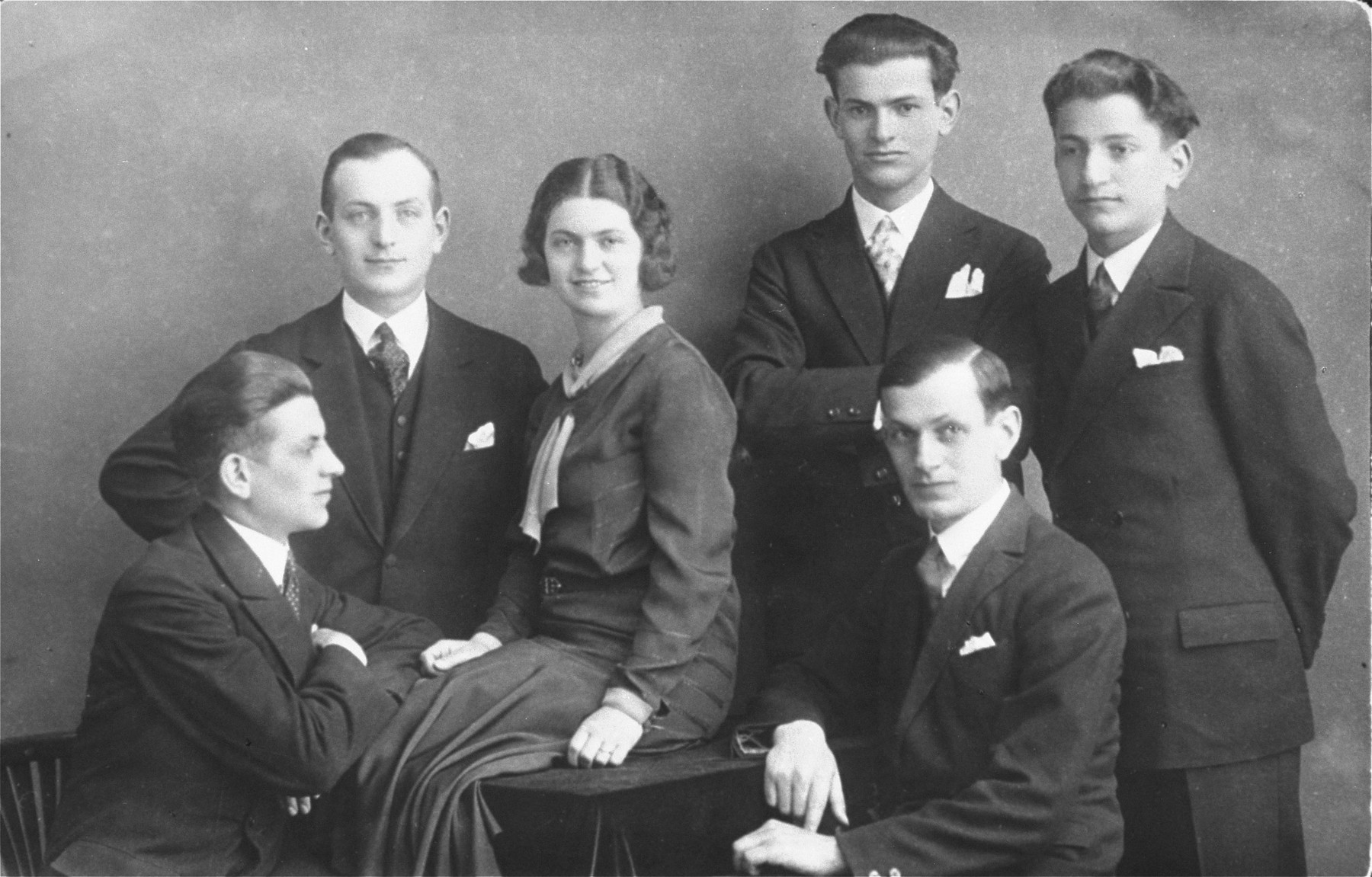 Group portrait of six Jewish siblings in Pozega, Croatia.  Pictured are the children of Julius and Rosa (Gruenwald) Klein.  From left to right are: Zdenko (seated) and Zlatan Klein (standing), Blanka (Klein) Kupfermann, Milan (seated), Dragan (standing behind Milan), and Bruno Klein.  All of the men perished in the Holocaust.