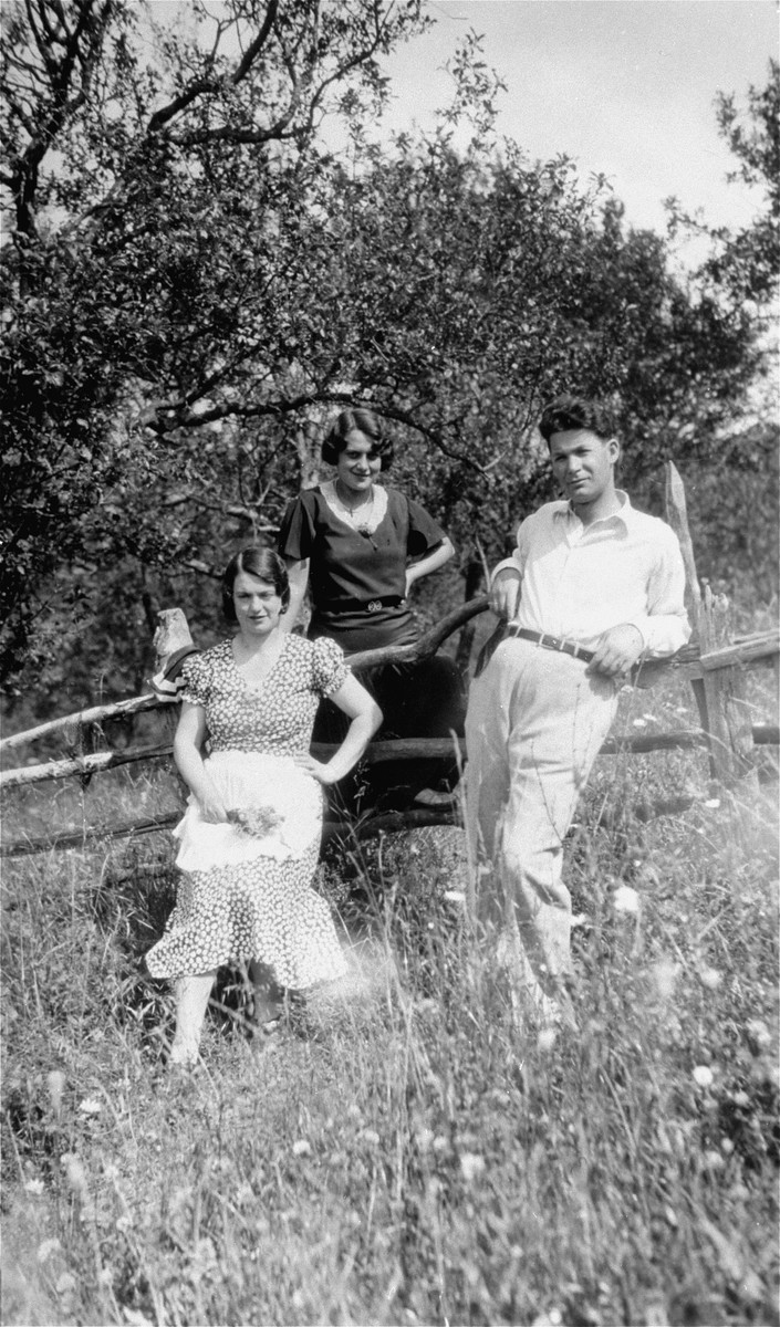 Members of the extended Kupfermann family pose in the countryside.  Pictured from left to right are Blanka, Margit and Andres Kupfermann.  Andres and Margit are the brother and sister-in-law of Beno Kupfermann.
