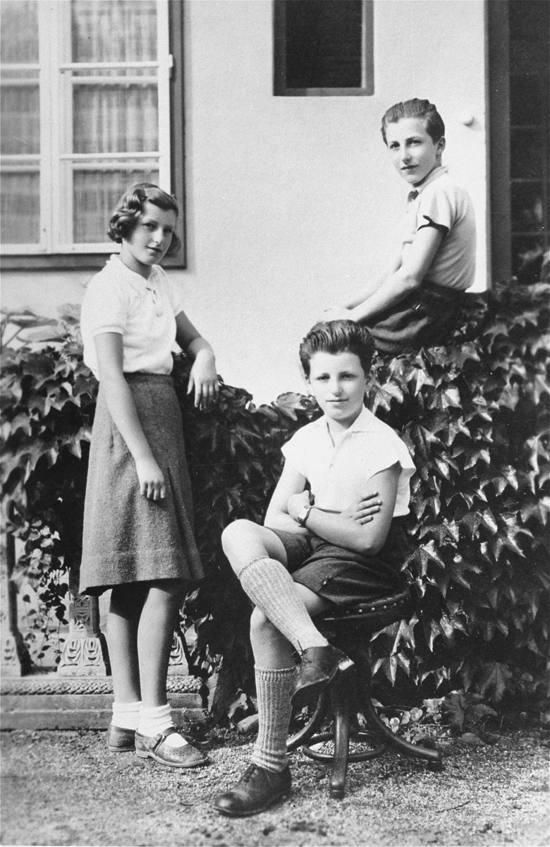 Three Jewish siblings poses outside their home in Vienna.  This was their last portrait before being sent on a Kindertransport to England.