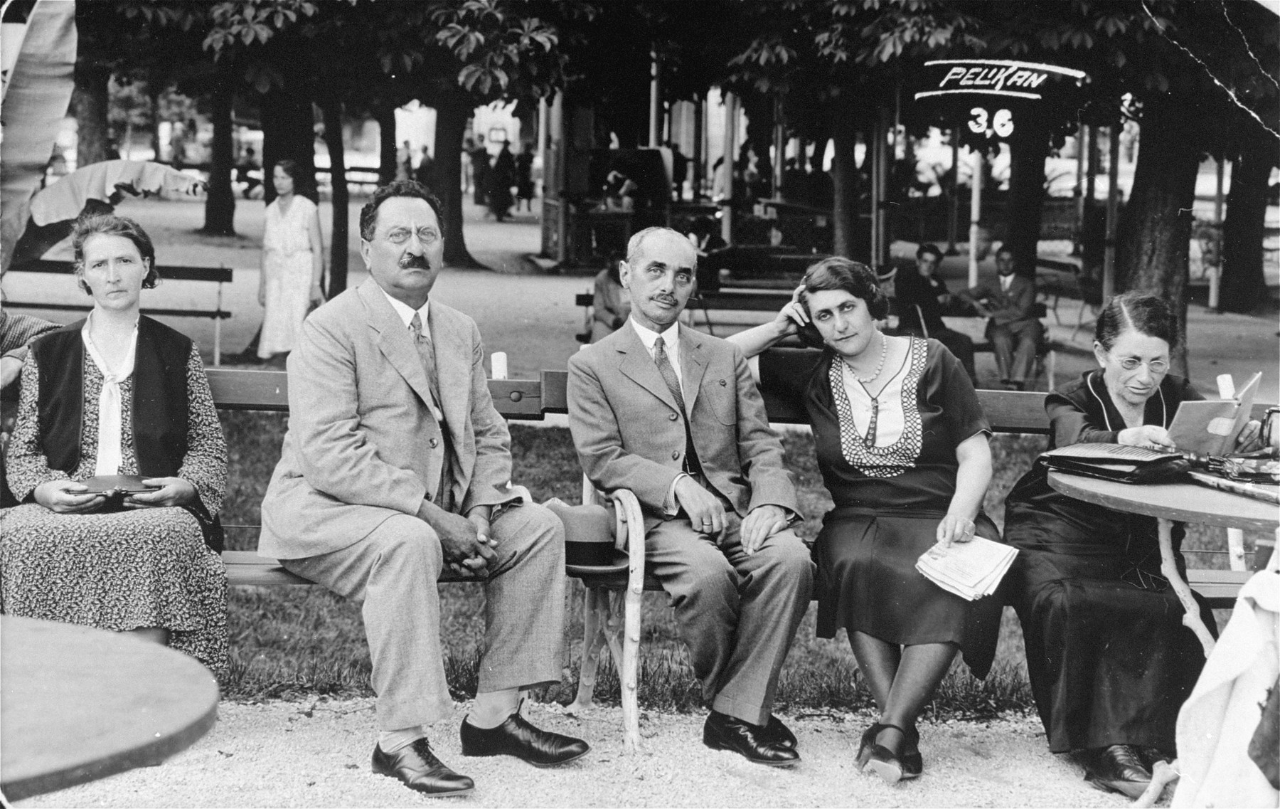 Members of the Klein/Kupfermann family sit in a park at a vacation resort in Croatia.