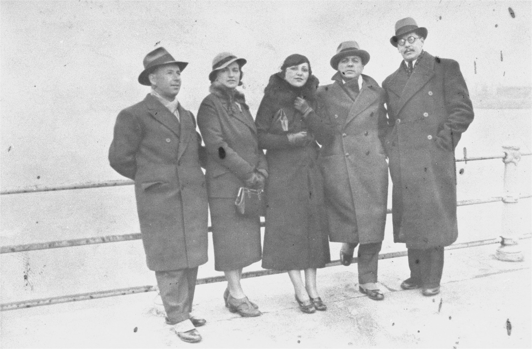 Group portrait of Jewish couples from the Balkans on board a ship during a sightseeing excursion to Palestine.  Among those pictured are Beno and Blanka Kupfermann (left).