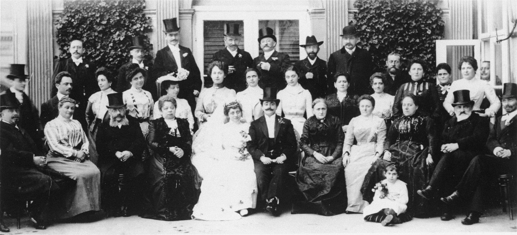 Family photograph taken at the wedding of Lili Kafka and Dr. Eduard Bloch.    Among those pictured is Egon Kafka, the donor's father, (standing in the back row, first from the left).
