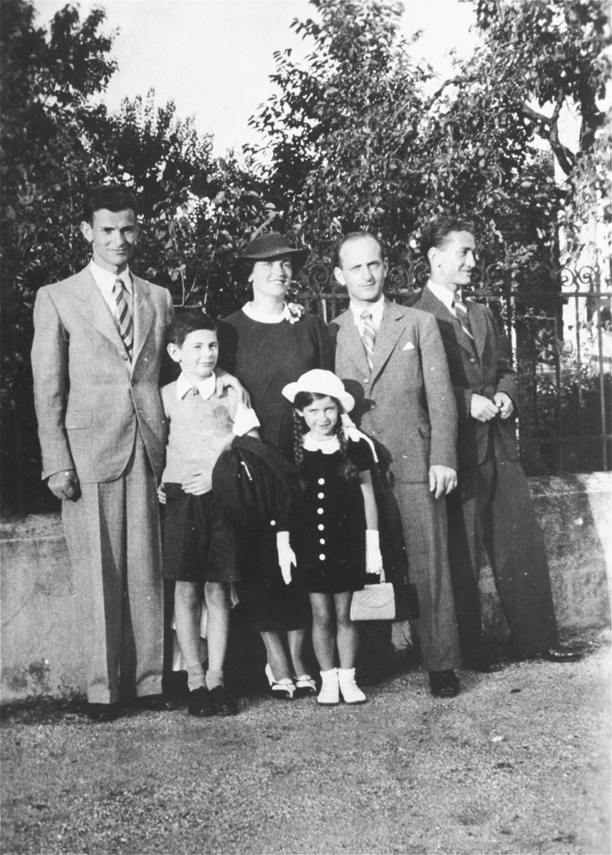 Portrait of a Jewish family in Zagreb, Croatia.   Pictured are members of the extended Klein family.  Standing in front are Aurel and Marta Kupfermann.  Behind them, standing from left to right are:  Dragan Klein, Blanka Kupferman, Zlatan and Bruno Klein.