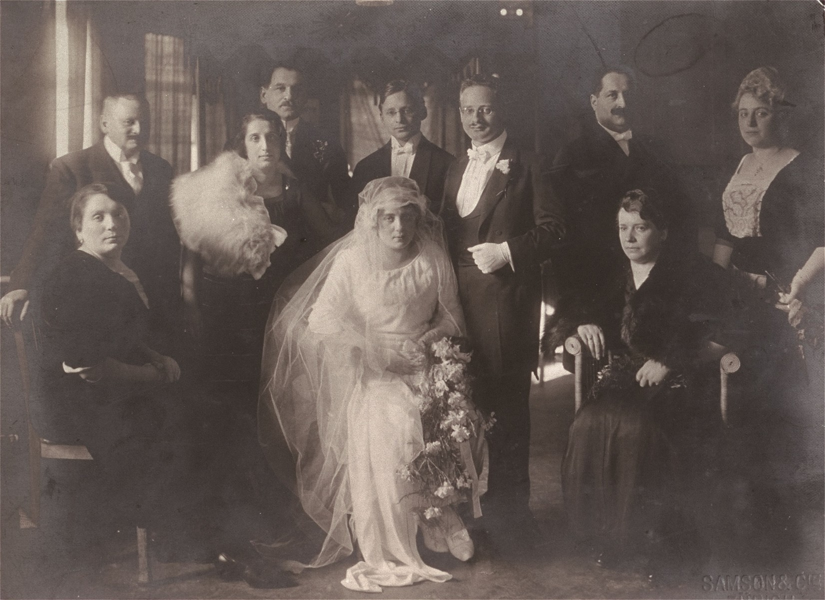 Portrait of the Braunschweig family at the wedding of Klara Braunschweig Woltar and Egon Kafka.    Pictured from left to right are: Leone and Leopold Blatt (Klara's sister and brother-in-law); Isaac Braunschweig (Klara's half brother) and his wife; and Herbert Braunschweig (Klara's brother); Egon Kafka; Rene and Bertha (Braunschweig) Weil (Klara's brother-in-law and sister). Sitting on the right is Regine Braunschweig (Klara's half sister).