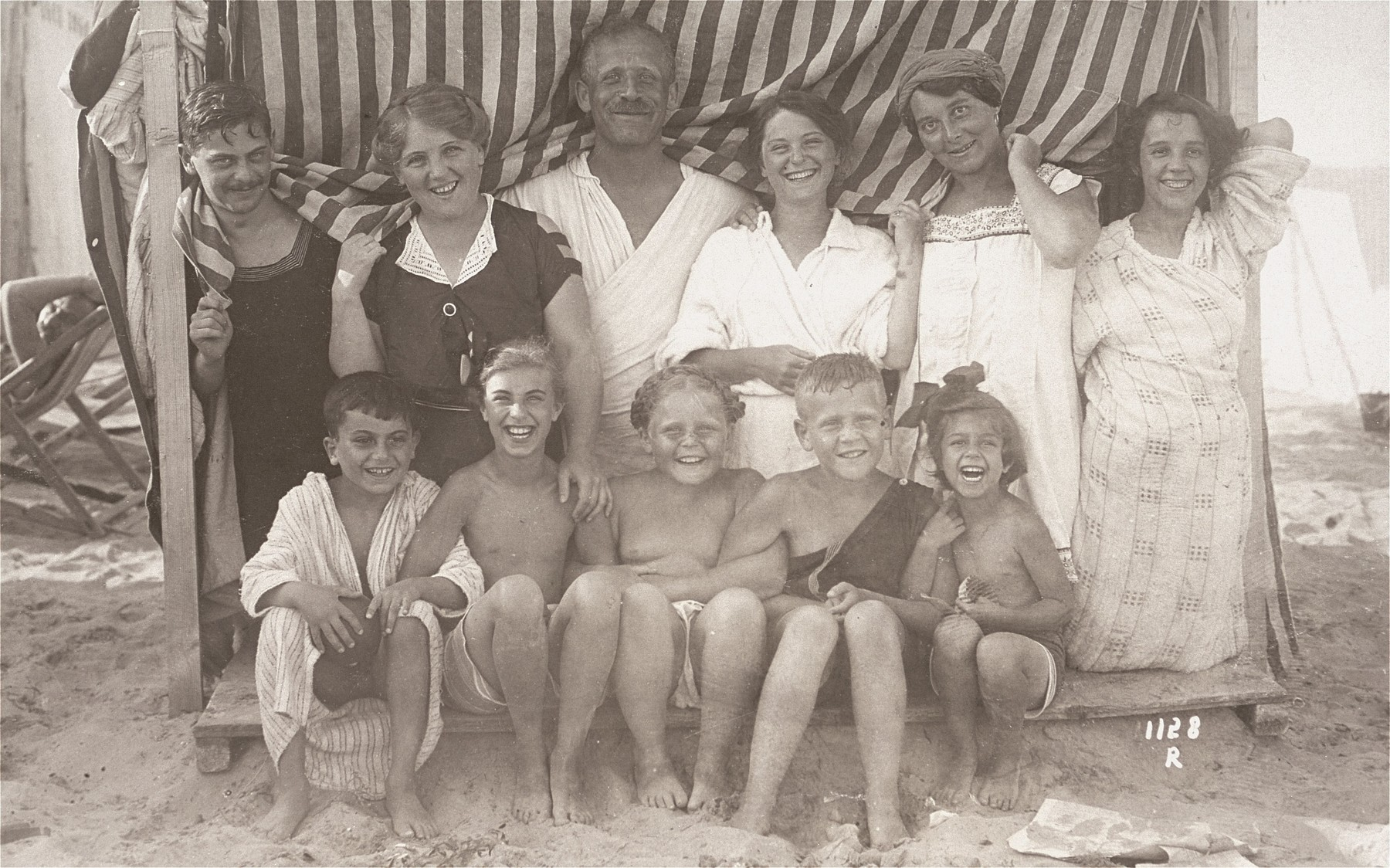 Artur and Luise Koenigstein pose with their children in a cabana on the beach during their summer vacation.