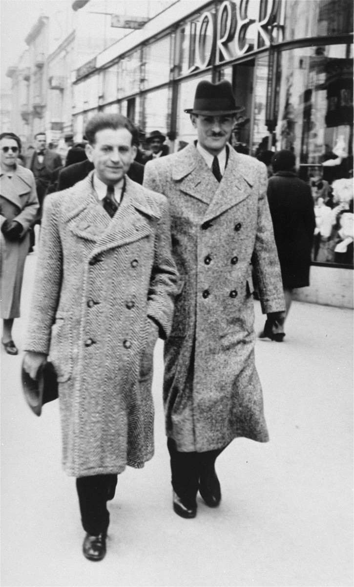 Two young Jewish businessmen walk along a commercial street in Zagreb, Croatia.  Pictured are the brothers, Zdenko (left) and Dragan Klein.