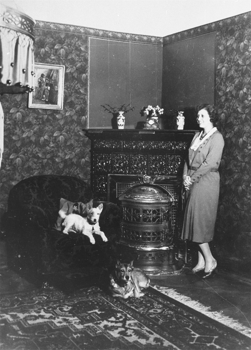 Olga Fuchel relaxes with her dogs in the Vienna apartment she shared with her husband, Rudolf.     The Fuchels were evicted shortly after the Anschluss.