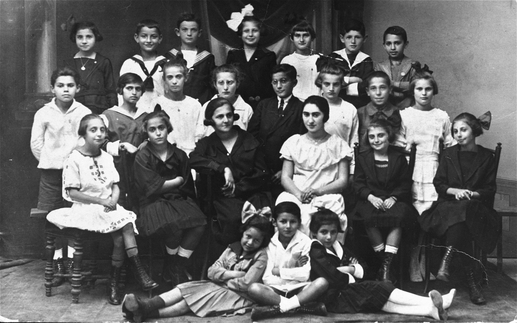 Group portrait of the members of a Zionist youth group in Pozega, Croatia.  Among those pictured is Bruno Klein (top row, second from the left), the uncle of the donor.