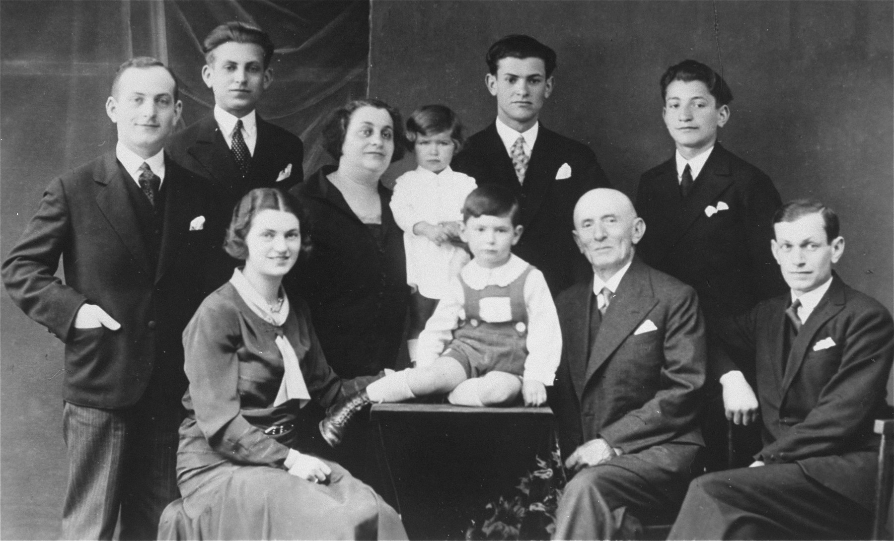 Studio portrait of an extended Jewish familyin Pozega, Croatia.  Pictured are members of the Klein/Kupfermann family.  Seated in the front row from left to right are: Blanka and Aurel Kupfermann, Julius and Milan Klein.  Standing behind from left to right are: Zlatan, Zdenko and Rosa Klein, Marta Kupfermann, and Dragan and Bruno Klein.
